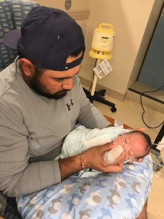 Daddy feeding Scarlett